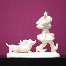"White Parian GOEBEL figurine girl & sausage dogs BYJ25 ""Putting on the dog"""