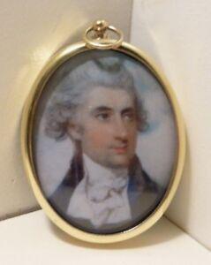 Miniature of Georgian gentleman wearing blue jacket in brass bezel.