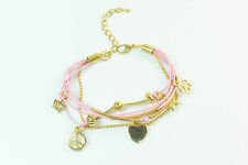 PRETTY IN PINK CHARM BRACELET WITH DELICATE GOLD COLOURED CHARMS (CL11)