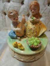 "Josef Originals Boy Seranading Girl Music Box plays ""Little Green Apples"""