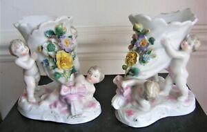 Pair of flower encrusted cornucopia with cherubs made by Wallendorf
