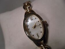 "Quartz ladies watch 7"" with 3/4 inch xtra link mother of pearl face very nice"