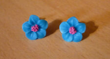 Felle turquoise bloem oorbellen met fuchsia centrum  NIEUW