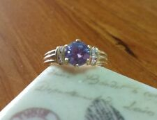 14k Yellow Gold Ring with Simulated Blue and Simulated white Diamonds