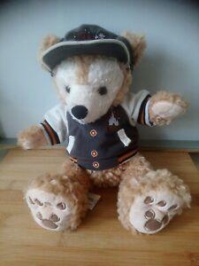 Peluche ours Duffy blouson casquette Disneyland Paris