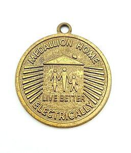 Vintage GOLD MEDALLION HOME Live Better Electrically. solid metal MEDAL PLAQUE