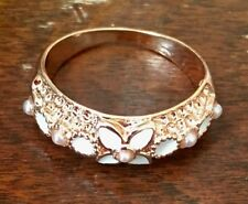 Beautiful golden pink ring with white enamelled floral pattern NEW WITH BOX