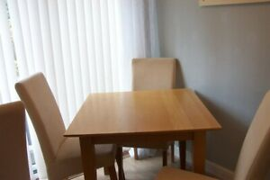 lovely table and 4 chairs vgcd
