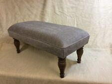 Footstool upholstered In Mobus Darwin mink beige fabric