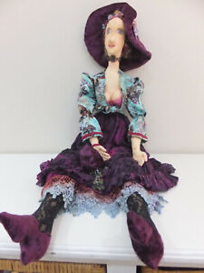 A gorgeous large, soft cloth art doll dressed in stunning outfit handmade
