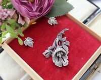 VINTAGE 1950's MARCASITE BROOCH AND CLIP ON EARRINGS IN ORIGINAL BOX.