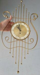 MID CENTURY WELBY 8 DAY WALL CLOCK  WORKS  24 X 11.5