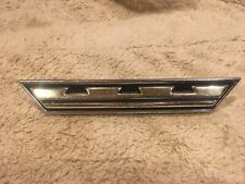 1964 Chrysler Newport Grille Medallion Moulding # 2417747
