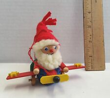 """VINTAGE 3 1/2"""" Wooden Elf in Airplane CHRISTMAS ORNAMENT"""