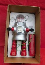 PISTON ACTION ROBOT.  Hauteur 25 cm. Tôle sérigraphiée, avec batterie