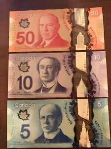 Canada 5 + 10 + 50 Banknotes. 65 Canadian Dollars Total. 3 Cir Banknote.