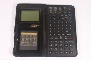 SHARP IQ-7000,vintage organizer/calculator.(ref E 754)