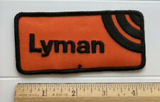 "Lyman Firearms Rifles Muzzleloaders Black Orange 4.25"" Long Embroidered Patch"