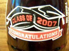 CLASS  OF  2007,  [ CLASS  OF  2007  is on the neck ]  1 - 8 Oz Coke Bottle