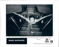 1998 1990s Pop Singer Alanis Morisette Takes the Escalator Press Photo