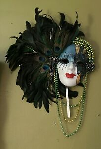 Mardi Gras Wall Mask with plumes of Peacock feathers and beads.