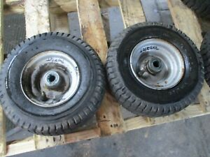 TORO 8/25  PAIR SET FRONT WHEELS AND TIRES 11X4.00-6