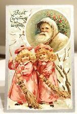 Twin Girls sweeping the snow away for Santa Claus. Raphael Tuck Xmas Postcard