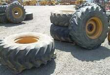 Set of Two Used Toyo 10 Ply 18.4 x 24 Tires on Wheels