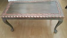 Upcycled shabby chick coffee table in rose gold hasd carved details, ball feet