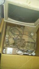 Working commadore amiga 500 with original monitor, manuals, and random software.