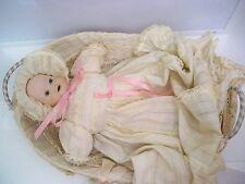 OLD BISQUE BABY DOLL IN ORIGINAL WICKER BASKET