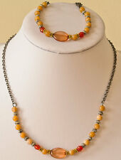 Necklace/bracelet set in acrylic beige and orange beads and black plated chain