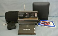 CASED POLAROID IMAGE WITH CLOSE UP LENS & REMOTE-CONTROL SYSTEM - FULLY WORKING.