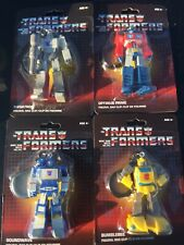 Lot of 4 Transformers G1 Keychain Bag Backpack Clip Optimus Soundwave Bumblebee