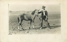 REAL PHOTO POSTCARD - COWBOY AND PONY - OLD VIEW