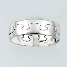 9ct. White Gold Puzzle Ring.