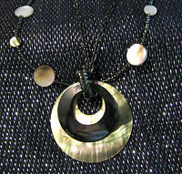 Dark metal necklace with small dark beads and pretty pendant