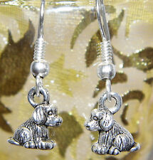 A Brand New Pair of Silver Puppy Dog Earrings