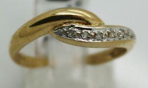 9ct yellow gold grain set diamond crossover ring