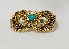 1950's vintage brooch red faux diamonds and turquoise stone in the center