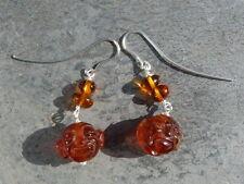 Boucles d'oreilles argent 925,6 ambres dont 2 sculptés en tête de bouddha