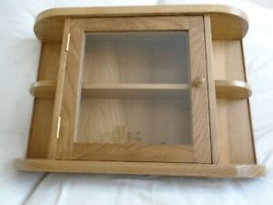 A small wall cabinet in solid oak