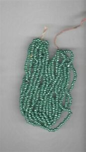 Vintage opaque green glass seed beads with luster--20 per inch.