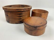 Two Antique wooden grain measures and a bentwood  pantry box