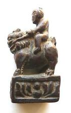 SMALL FOLKY MING DYNASTY WOOD CARVING OF A LOHAN RIDING A TEMPLE LION