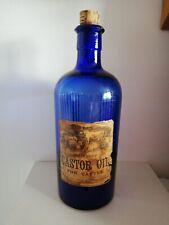 More details for vintage old antique cobalt blue poison bottle paper label castor oil for cattle