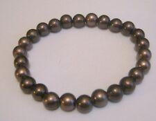 Lovely bronze tone plastic beaded elasticated bracelet