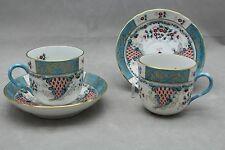 PAIR HEREND CORNUCOPIA CUP AND SAUCERS, 1727 TCA