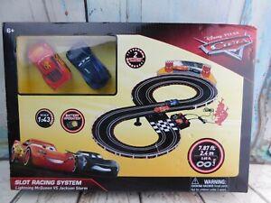 NEW Disney Pixar Cars 2 Slot Racing System Lightning McQueen VS Jackson Storm
