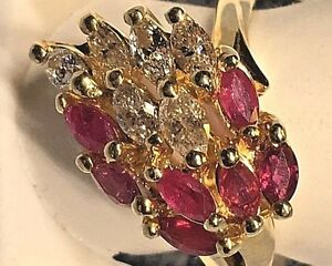 LADIES FINE14KT GOLD RUBY + DIAMOND RING    RETAIL $  2900.00